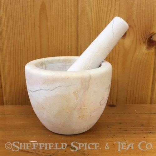 beige marble mortar and pestle